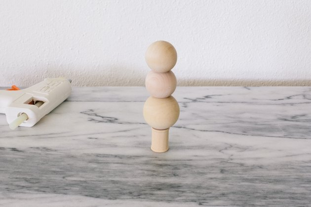 Gluing wooden beads to wooden spool