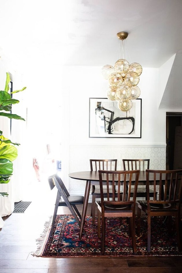 Bohemian dining room lighting idea with contemporary gold chandelier