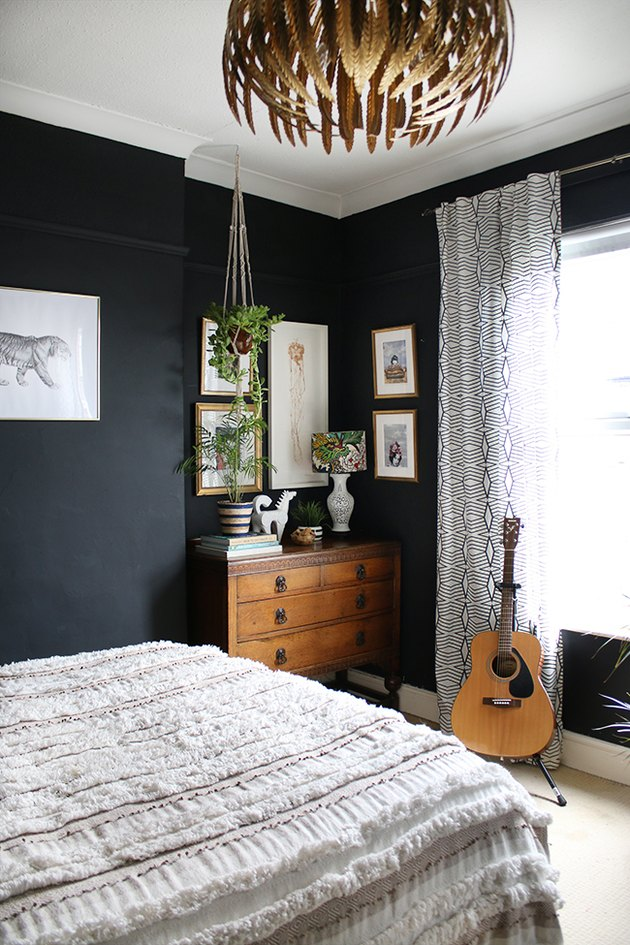 eclectic bedroom with black walls