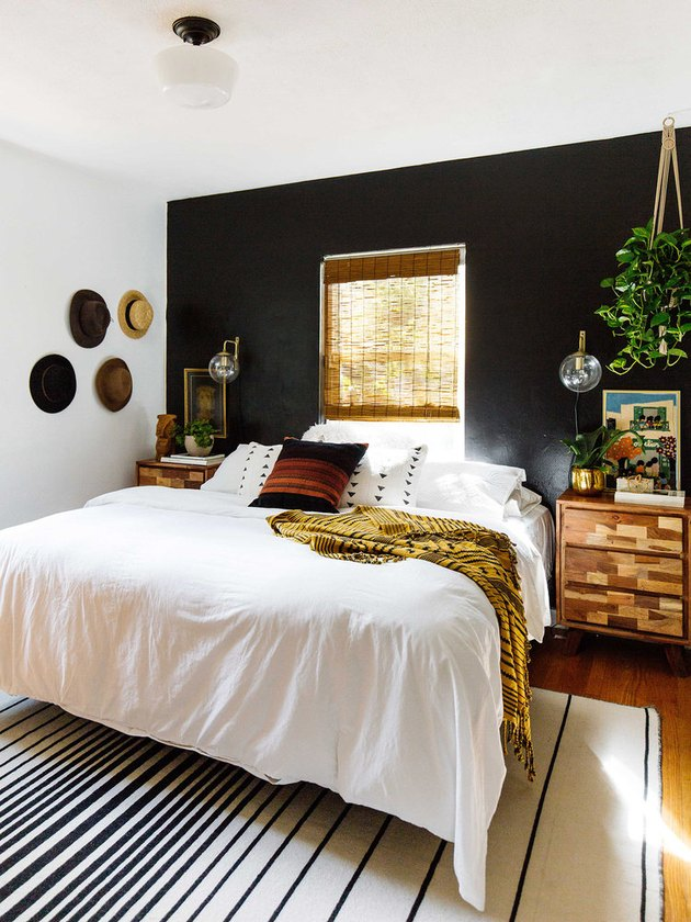 bohemian bedroom with black accent wall