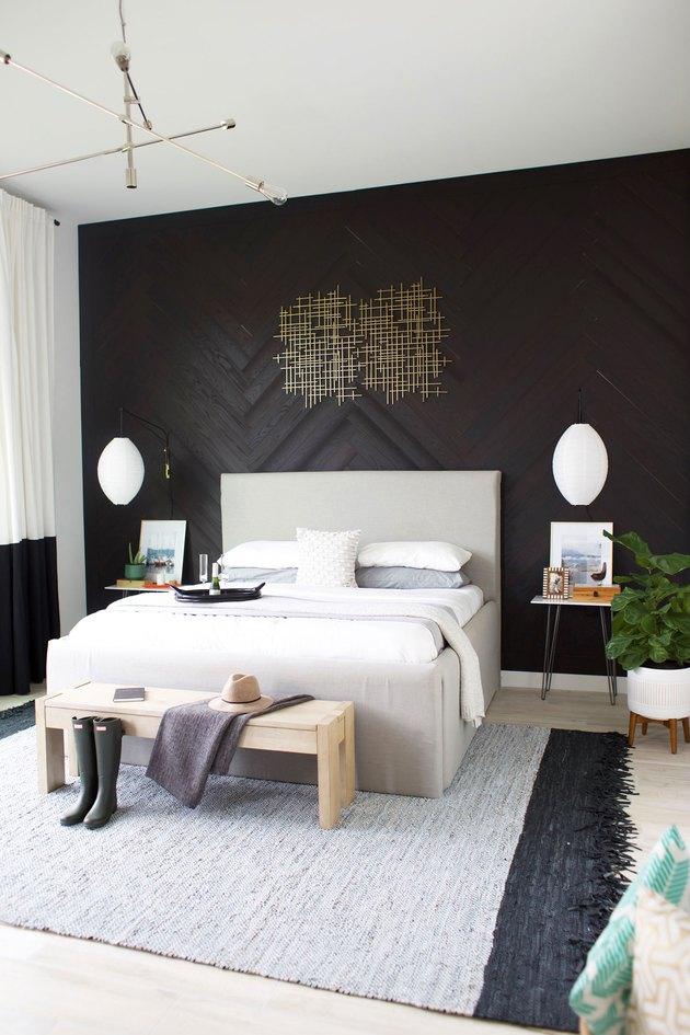 bedroom accent wall with charcoal wood panels in herringbone pattern