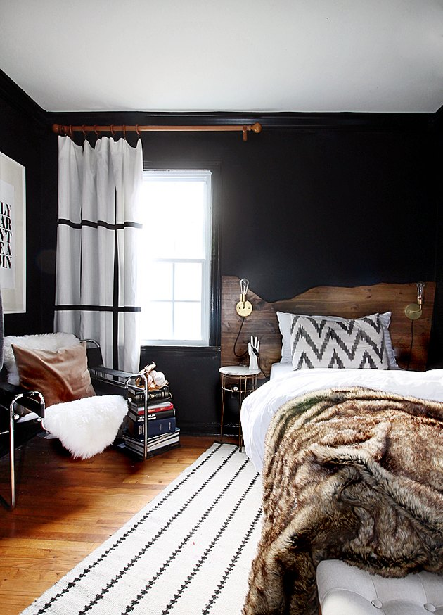 bedroom with black walls and live edge headboard