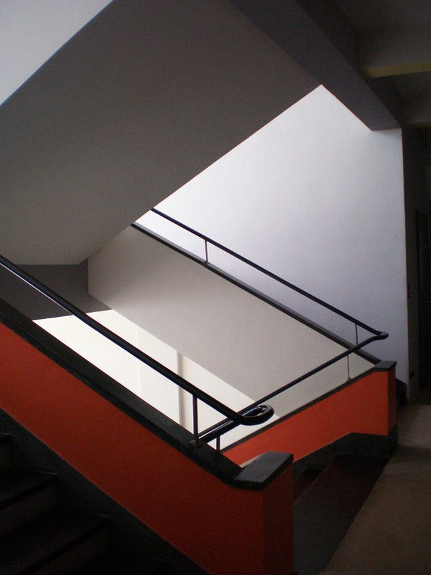 Bauhaus architecture with modern stairwell in red and black