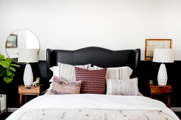 bedroom with black wainscot and black upholstered headboard