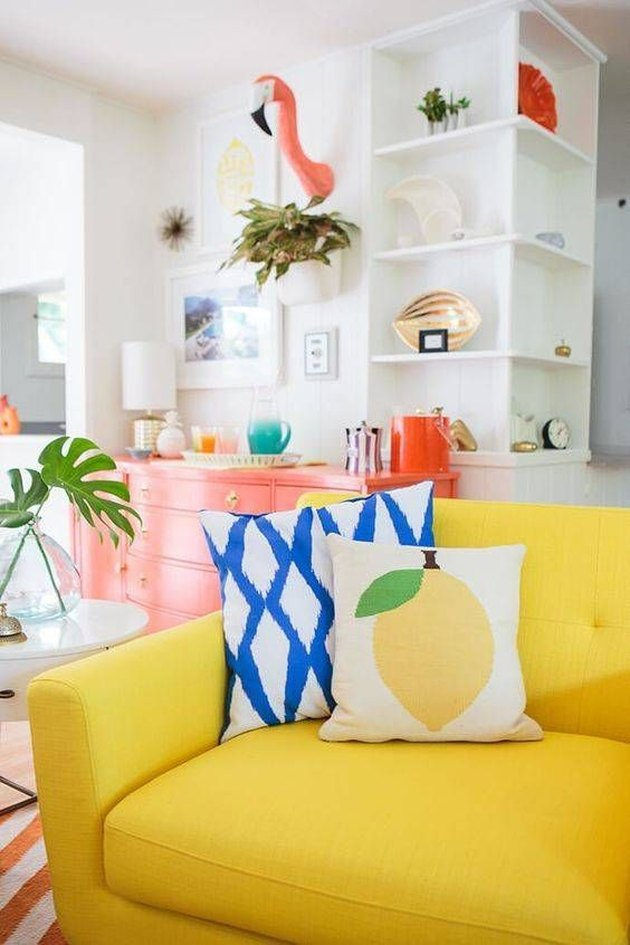 tropical living room with yellow sofa