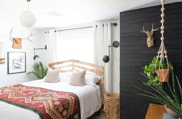 Scandinavian-inspired bedroom with black shiplap walls