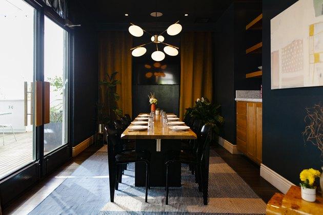 A dark green dining room