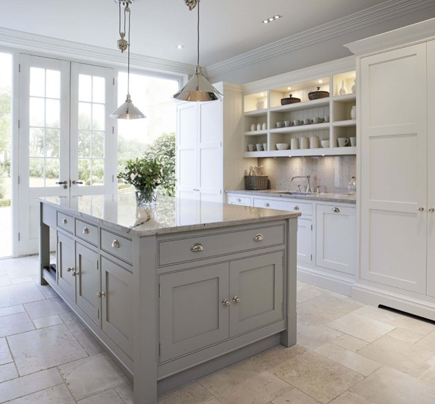 tumbled travertine kitchen flooring with gray cabinets and open shelving