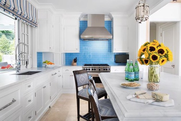 travertine kitchen flooring with blue subway tile backsplash