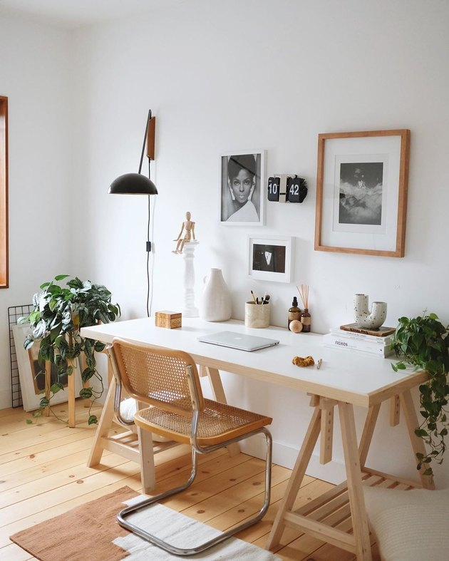 work space with gallery wall and lamp