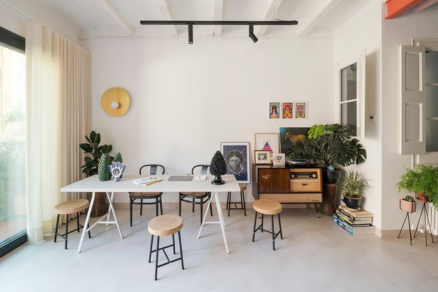 white home office idea with desk in the middle and track lighting