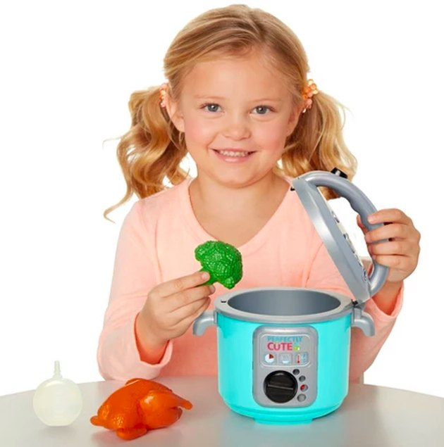 girl with toy instant pot
