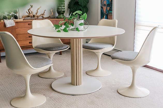 IKEA dining table with dowels and tulip chairs