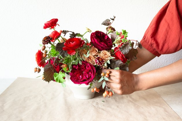 fall-themed floral centerpiece with burgundy flowers