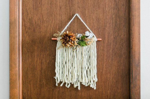 DIY door hanging made with yarn and copper pipe