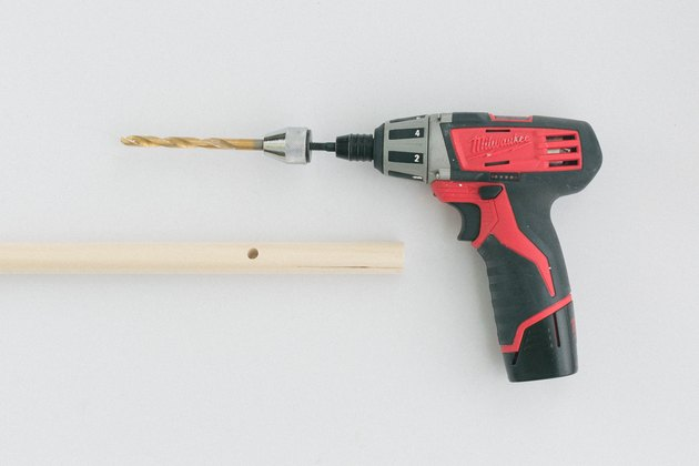 Drill through the mark with a cordless drill and drill bit.