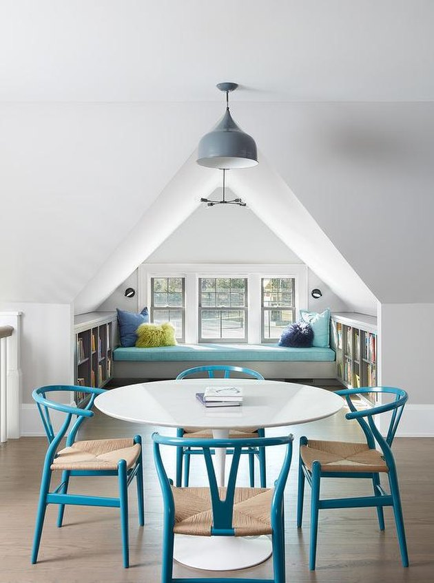 cheerful attic idea with table and chairs and window seat