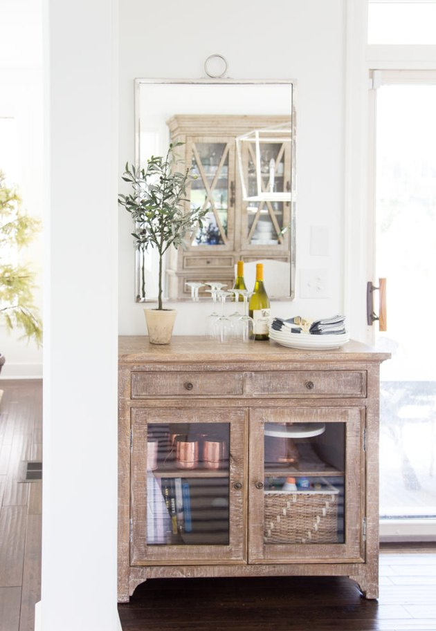 Small dining room storage idea with vintage-inspired buffet