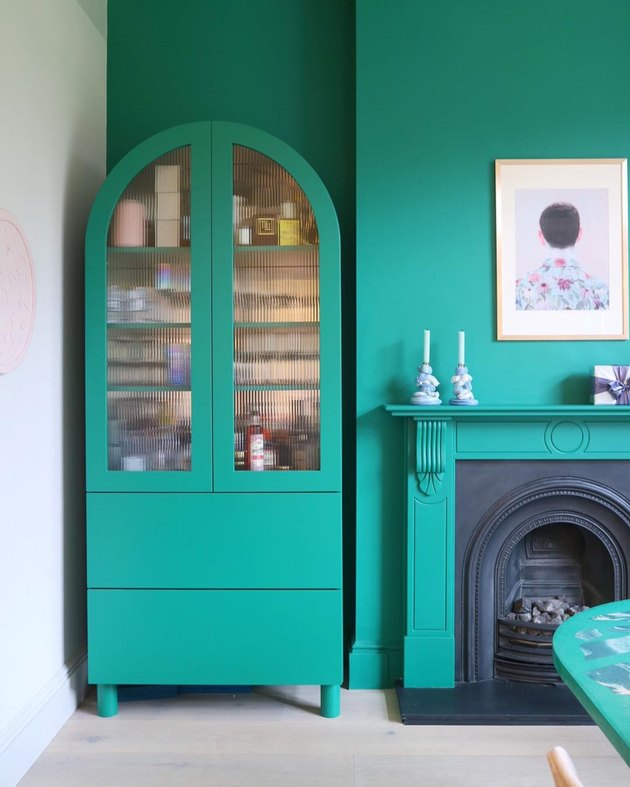 green cabinets against matching green walls Tone On Tone Paint Ideas