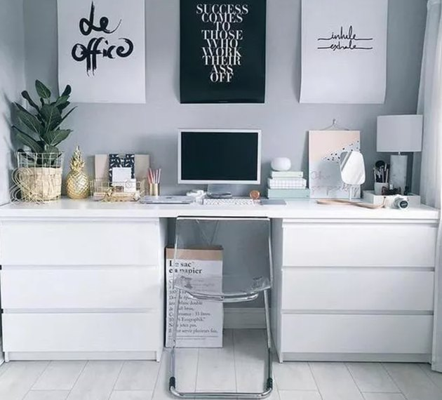 Home Office Organization Ideas with White desk with drawers, wall with art, plant.