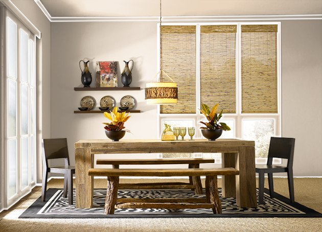 dining room space with beige walls and wooden table