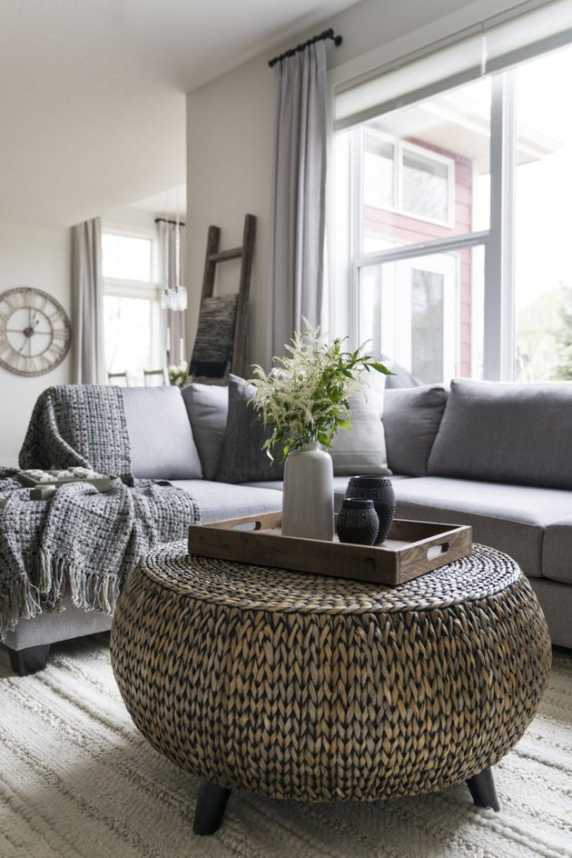 farmhouse living room with woven coffee table