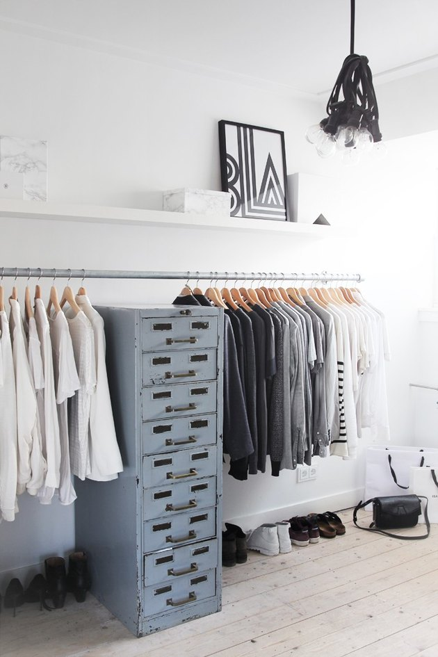 Industrial pipe closet idea with metal industrial file cabinet and modern decor