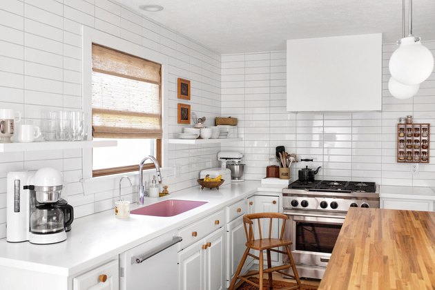 white subway tile kitchen backsplash in straight line