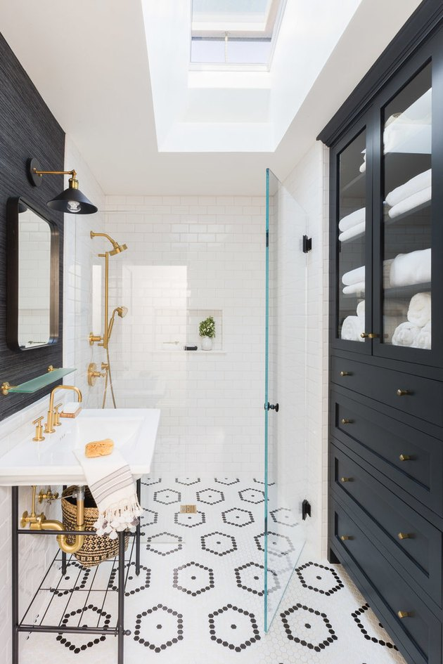 bathroom storage idea with oversize cabinet and mosaic tile flooring