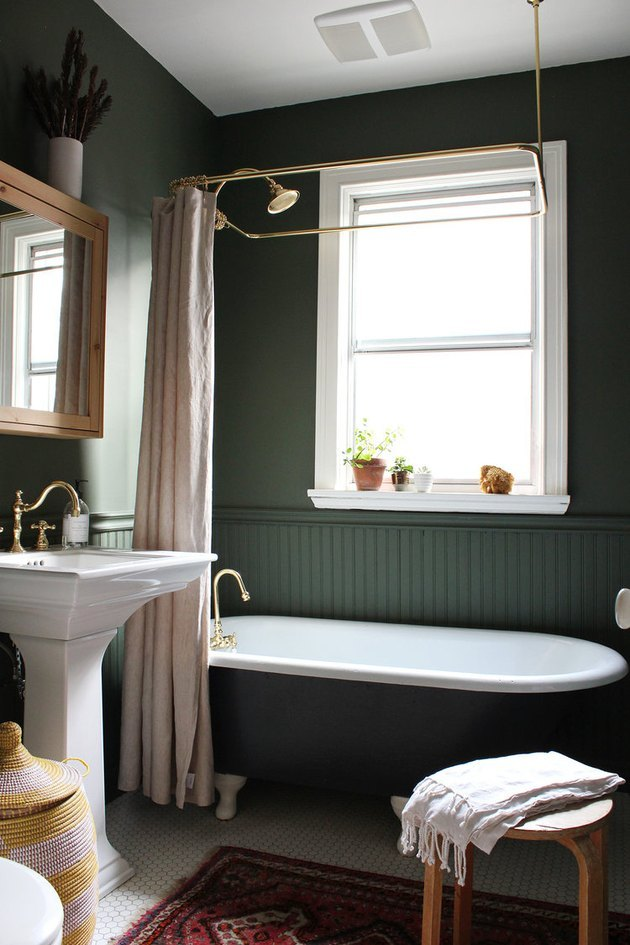 green bathroom with wainscoting