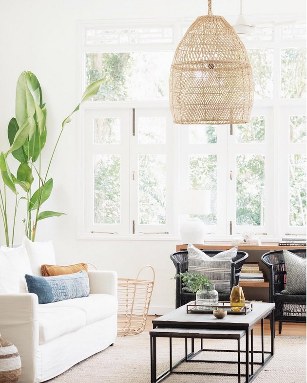tropical living room with woven pendant light