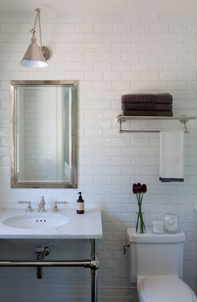 bathroom storage idea on wall in small space with console sink