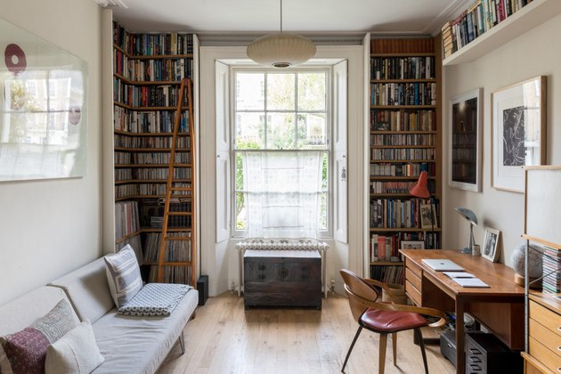 Home Office Built Ins with Floor-to-ceiling built-in library in London home on Modern Street
