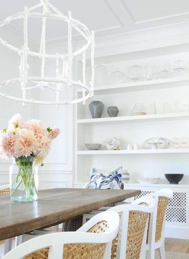 dining room with white chandelier and white built-in storage