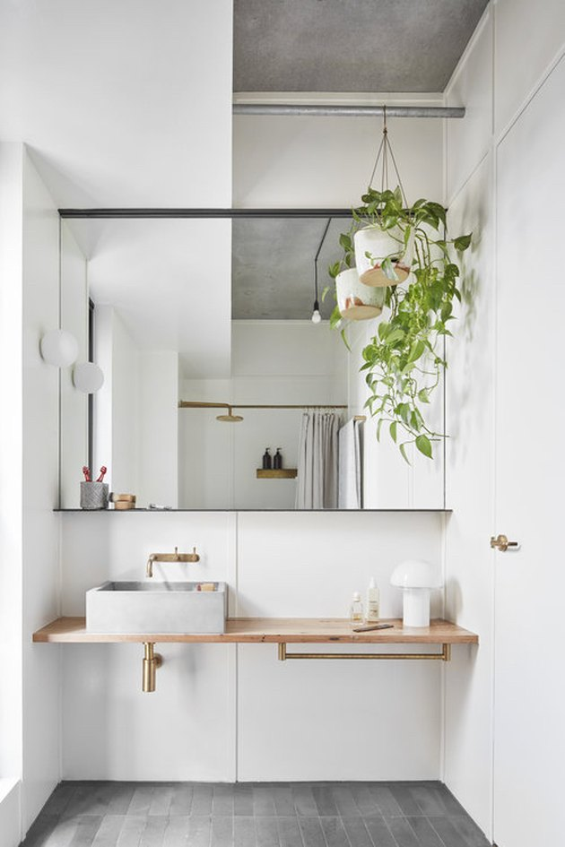 Scandinavian bathroom with vessel sink and floating vanity