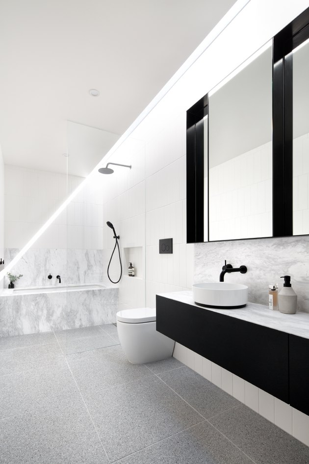 black and white Scandinavian bathroom with floating vanity