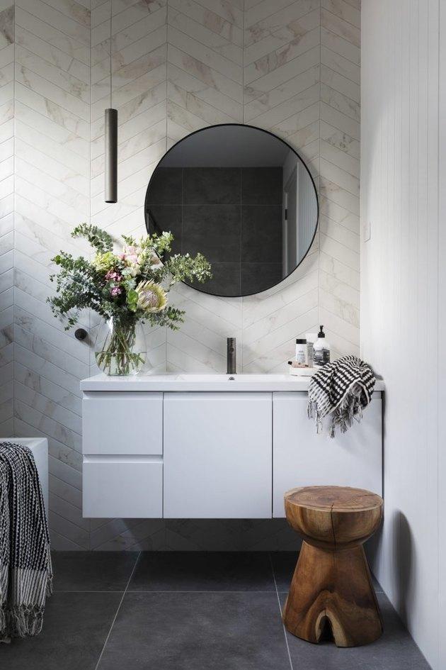 bathroom lighting idea with pendant light hanging over vanity cabinet