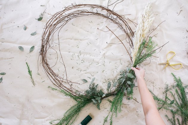 Attaching floral bundles to wreath
