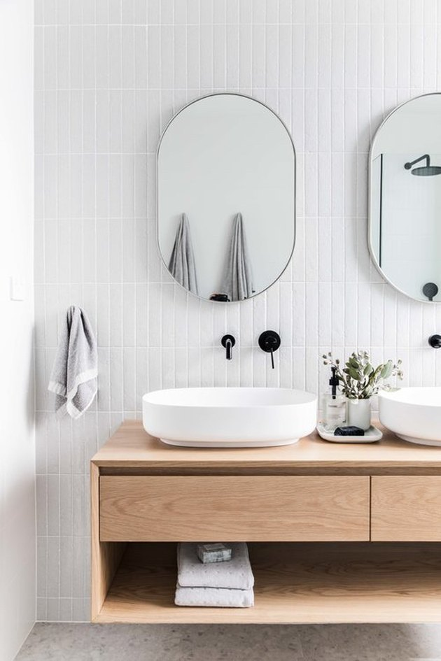 Scandinavian bathroom with floating vanity and vessel sinks