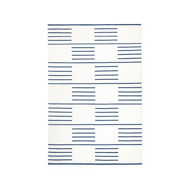 Cream rug with sections of thin blue stripes in checker pattern