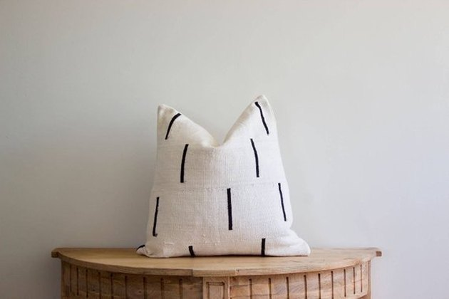 White throw pillow with spaced out single thin black stripes