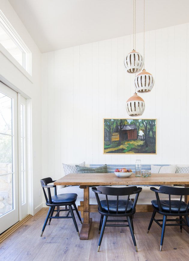 classic dining room lighting idea with handmade ceramic pendant lights