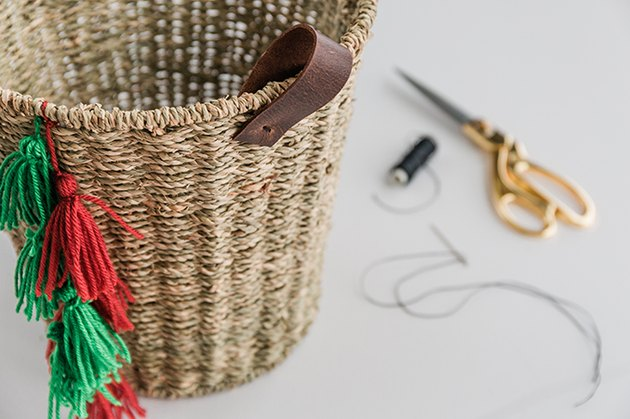Sew leather handles onto the sides of the basket.