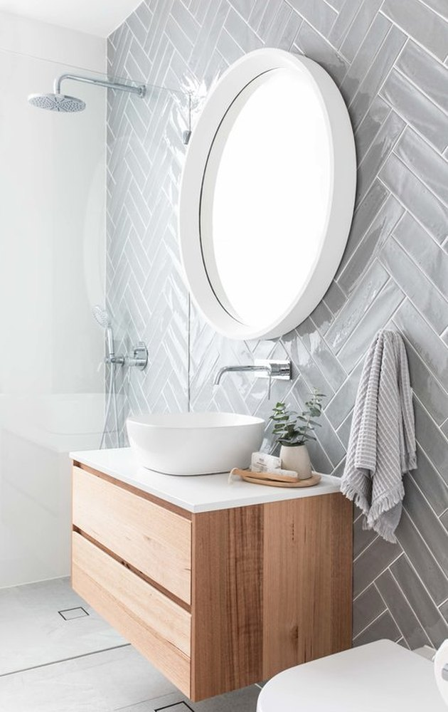Scandinavian bathroom with herringbone pattern wall tile