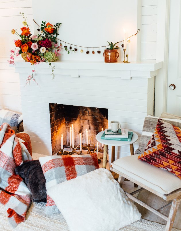 fall-inspired mantel decor with seasonal flowers and garland