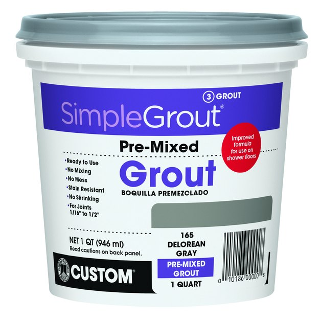 Tub of tile grout.
