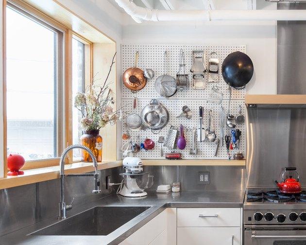 pegboard organizer in kitchen