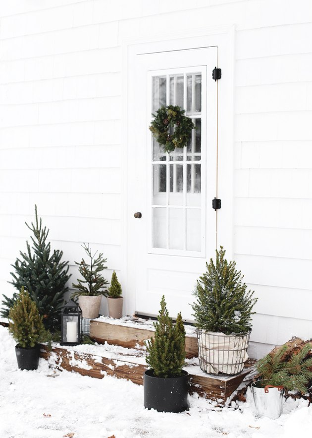 DIY Outdoor Christmas Decorations with Minimalist Christmas front porch with mini trees by The Merry Thought