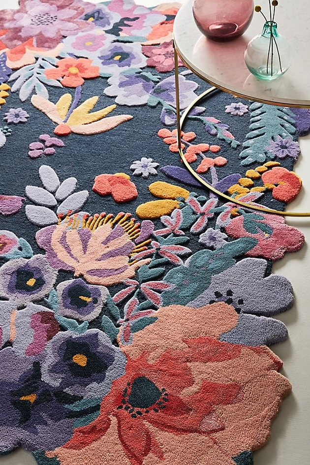 dining room rug idea with low-pile in a floral pattern with vibrant colors