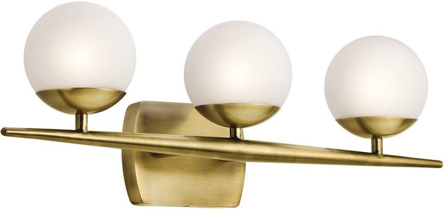 Three-globe sconce with brass details